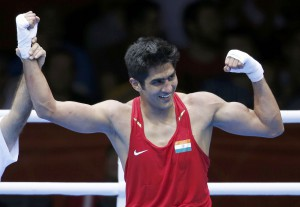 India's Vijender reacts after defeating Kazakhstan's Suzhanov in the Men's Middle (75kg) Round of 32 boxing match during the London 2012 Olympic Games